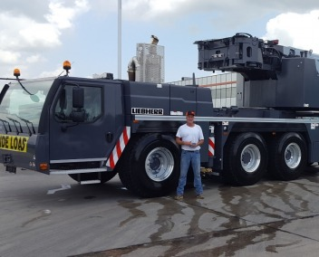 Owner Darcy Perry in front of a 300 Ton Liebherr Crane