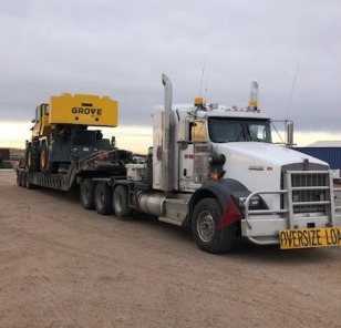 Hauling large equipment on a trailer