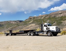 KP Squared truck and trailer providing heavy hauling services